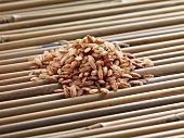 Red rice on bamboo sticks