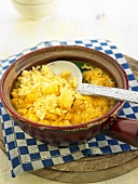 Arroz al horno (oven-baked rice, Spain) with cauliflower and stockfish