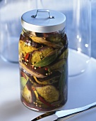 Spicy, pickled aubergines in a preserving jar