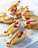 Fish-shaped puff pastries filled with mascarpone and berries