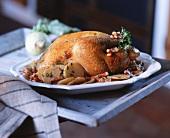 Huhn vom Grillspiess mit Kartoffeln & Speck
