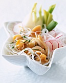Pasta salad with vermicelli, vegetables and mussels
