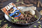 Ingredients for chai tea; ginger, cloves, cardamom, cinnamon, star anise
