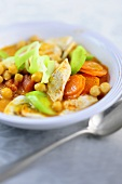 Chickpea stew with vegetables and chicken