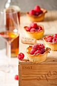 Raspberry tartlets and dessert wine