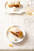 Apple strudel and a glass of white wine