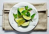 Lime wedges, mint and brown sugar