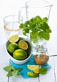 Ingredients for summer lemonade: lemon balm, limes, brown sugar