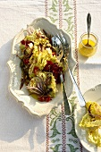 Radicchio salad with sardines, capers and pine nuts