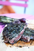 Grilled entrecote with herbs and red onions