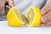 A lemon being halved