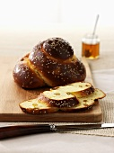 Challah with raisins and a jar of honey