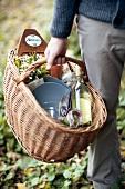 A man carrying a picnic basket