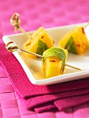Spicy chilli and pineapple cubes on sticks