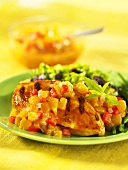 Grilled chicken breast with peach salsa and a side salad