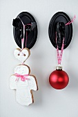 A shortbread angel and a Christmas bauble on a moose hook