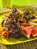 Jerk chicken with watermelon and vegetables