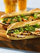 Grilled chicken sandwiches on baguette bread
