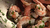Prawns with garlic, chilli and herbs in a wok