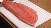 Cutting salmon fillet