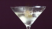 Garnishing Martini with an olive