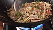 Chicken, vegetables and noodles in a wok