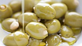 Green olives with almonds and olive oil