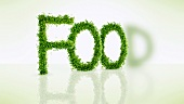 Cress in the shape of letters spelling the word 'FOOD'