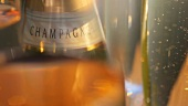 Champagne bottle and glasses of champagne (detail)