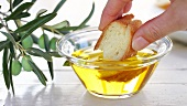 Pane e olio (Dipping white bread in olive oil, Italy)