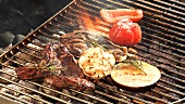 Lamb with vegetables on a barbecue