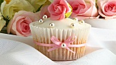 Cupcake with marzipan rose and silver dragees