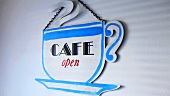 Cafe sign in shape of a cup of coffee