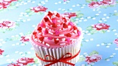 Cupcake with pink icing