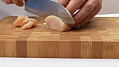Slicing chicken and turkey breast fillet