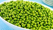A dish of cooked green peas