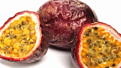 Purple passion fruit, whole and halved