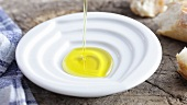 Pouring olive oil into a dish
