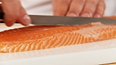 Removing the fat from a salmon fillet