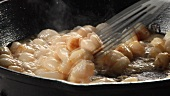 Scallops being fried