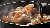Prawns and garlic being fried in a pan