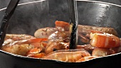 Prawns being fried in a pan