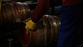 Inside a brewry: barrels being filled