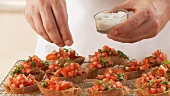 Bruschetta being sprinkled with salt