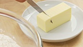 A piece of butter being chopped