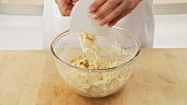 Ingredients for yeast dough being mixed and kneaded