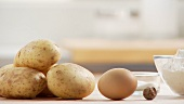Ingredients for gnocci: potatoes, egg, nutmeg and flour