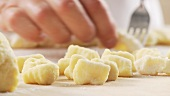 Gnocchi being rolled over a fork