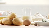 Ingredients for gnocci with gorgonzola sauce: potatoes, egg, nutmeg, flour, gorgonzola