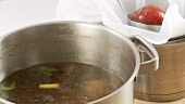 Beef stock being sieved